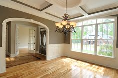 I love the molding, front door and color of the room!