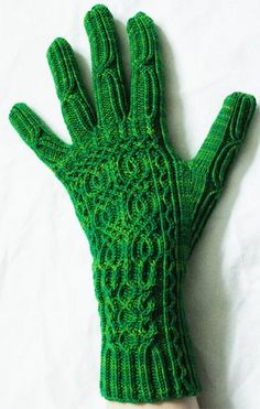 One-stitch columns of traveling stitches make such delicate cable work! Entangled Stitches by Julia Mueller (I think I'd leave the fingers plain, but I love the back of the hand)