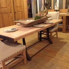 """Industrial dining table. Made from a antique workbench and a antique cast iron ironing press base. Notice the steel wrapped ends and the 2.75"""" butcher block top. 7' long and available for stain or natural with poly or wax."""