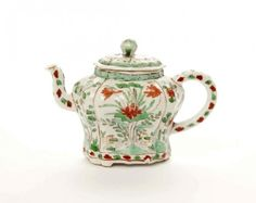 CHINESE KANGXI FAMILLE VERTE PORCELAIN TEA POT The covered lobbed-form pot is decorated with panels of chrysanthemums, plums, lotus flower and peonies. H. 10cm (4 in.)