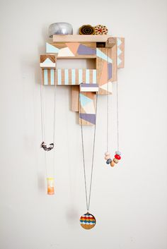 Lara Cameron's jewels on a timber jewelry hanger by Stampel