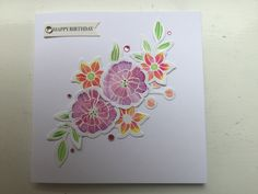 Stampin up falling flowers, embossed with white embossing powder, the flowers are then painted, before being die cut and then arranged on the card