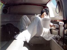 Prince lounging in his limo. Spy his wedge flip flops and socks. Too cute!