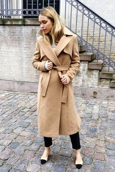 Trench coats are a favorite styling piece among fashion lovers. See how a blogger wears a full length camel trench coat.