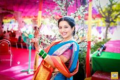A beautiful maharashtrian bride wearing a traditional paithani saree on her wedding day #Frugal2Fab