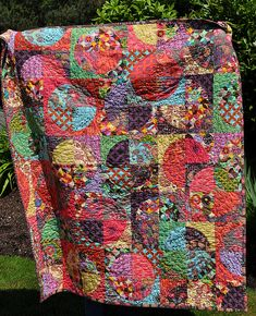 """KAH says: love the use of drunkard's to make circles. Great fabric choices--Quilt title is """"The Drunken Bohemian""""."""