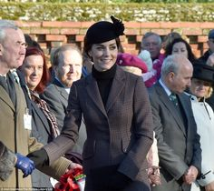 The Duchess extends a hand as she greets well-wishers and other guests at the service in Sandringham, Norfolk, yesterday morning