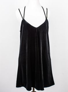 We're loving this 90's inspired Doll Heart black velvet mini slip dress. Pairs well with smudged eyeliner and mary janes with chunky heels :)