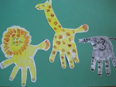 Zoo animals (lion, giraffe, elephant) toddler handprint art (with a little help from Mummy) - handprint calendar for Grandparents
