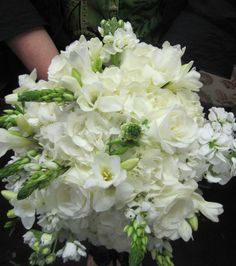 "Freesia, hydrangea, roses, and star of bethlehem for a touch of green.  This is a stanout bouquet.  Rounded yet ""free.""  LeFrancois, floral, flowers, wedding, bouquet, norwich, ct"