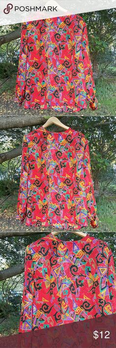 """{Vintage} colorful blouse Vintage funky pattern shirt. Tags are missing, but this definitely feels polyester. Has a few buttons in the back and also shoulder pads. Says dry clean only but you can wash this yourself.  Marked a vintage size 12, but please use the following measurements: 26"""" long  22"""" flat armpit to armpit  Sleeves measure 24"""" long Vintage Tops Blouses"""
