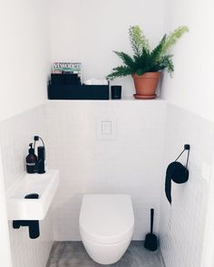 Is your home in need of a bathroom remodel? Give your bathroom design a boost with a little planning and our inspirational bathroom remodel ideas Small Toilet Room, Guest Toilet, Downstairs Toilet, Small Bathroom, Master Bathroom, Bad Inspiration, Bathroom Inspiration, Dark Tile Floors, Vintage Bathroom Decor