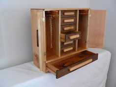 Handmade Wooden Hannah's Jewelry Box – Handcrafted Wooden Jewelry Box – Necklace holder – Black Walnut, Yellow Birch, Red Oak. $375.00, via Etsy.