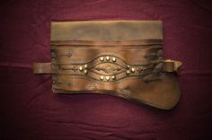 #Ottoman #leather #weapons #belt #selahlik #silahlik) worn throughout the Ottoman Empire, made from layers of leather containing slips to hold a yatagan sword and other weapons.