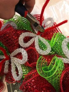 Want to learn how to make this gorgeous Christmas Deco Mesh Wreath with an in depth tutorial? A man carefully pinches red mesh—wait until you see his incredible Christmas front door idea! Your door is about to look SO good! Quilted Christmas Ornaments, Christmas Mesh Wreaths, Deco Mesh Wreaths, Christmas Crafts, Christmas Decorations, Winter Wreaths, Yarn Wreaths, Floral Wreaths, Spring Wreaths