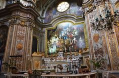 """San Nicola Carità, Naples.  The sanctuary is made up of a major altar in polychrome and commemorative marbles of 1743 by Antonio Troccola.  Behind it lies the great altarpiece of """"St. Nicholas' Death"""" dated 1707, the work of De Matteis,"""