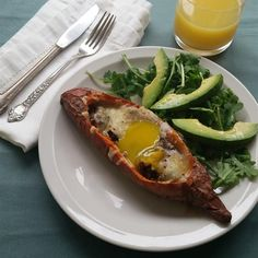 """Cheesy Chorizo and Egg Sweet Potato Boats   """"These twice-baked sweet potatoes are savory and perfect for a weekend breakfast or weeknight dinner."""