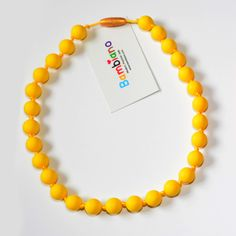 Bambiano Nicole Jr Necklace in Sunflower Yellow . Bambiano Jr Necklaces are made of 100% Food grade silicone. BPA free, Lead free and nontoxic. Fashionable for trendy girls 3 years and above. Necklaces are colourful, washable and soft against the skin. Shop at www.bambiano.com