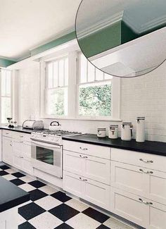 Small-scale Early American molding helps this reworked kitchen appear larger. The cyma recta curve (concave at the outer edge and convex at the inner edge) where the crown meets the ceiling and simple beading makes this molding just enough of an accent for this bold-colored kitchen.