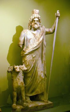 An impressive statue of Hades, the ancient Greek god of the underworld accompanied by his three-headed guard dog Cerberus