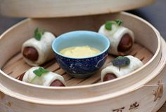 The Dawson in West Loop serves up Pigs in a Blanket made with Mandarin-style pork sausage, bao, and spicy mustard.