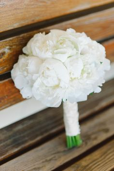White peonies in an all white bouquet. I love the idea of having a black and white wedding, focusing more on white.