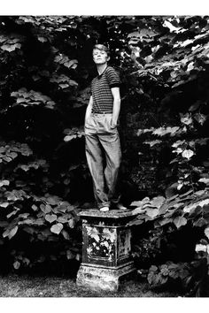 Photographed by Lord Snowdon wearing a T-shirt and loose trousers, in a portrait for Vogue.