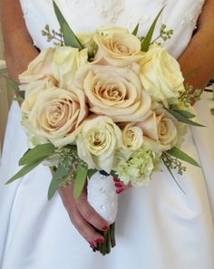 Blush and ivory roses with seeded eucalyptus.