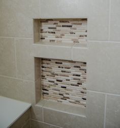Check out these tile in the wall niches to hold toiletries