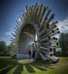 Artist Luke Jerram designed this large Aeolian harp to make audible the shifting wind patterns. At Canada Square Park, Canary Wharf, London.