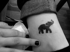 Elephant tattoo  Less cartoonish, more realistic. Cute in hot pink for maggie. Or maybe pale pink. Or black. who knows.