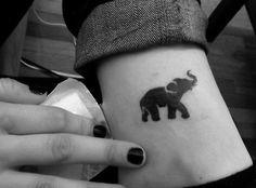 Elephant tattoo  Less cartoonish, more realistic.