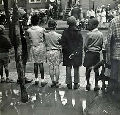 Children playing ring around a rosie in one of the better neighborhoods  of the Black Belt, Chicago, Illinois, 1941