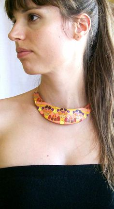 Art deco choker bib necklace art nouveau polymer clay necklace in pink, purple, red, orange and yellow hues with gold decorative fashion. $66.00, via Etsy.