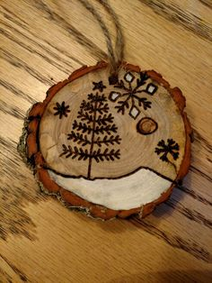 Evergreen and snowflake ❄️ Wood Slice Crafts, Wood Burning Crafts, Wood Burning Patterns, Wood Burning Art, Wooden Crafts, Western Christmas Tree, Cowboy Christmas, Primitive Christmas, Wooden Ornaments