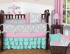 The 9pc Skylar baby bedding collection by Sweet Jojo Designs will create a stunning boutique setting for your nursery. This bright and bold designer girl crib bedding set uses a sensational collection of exclusive 100% Cotton fabrics. It combines a chic grey and white damask, a coordinating candy pink and white polka dot, and solid turquoise cotton. The dazzling color palette of candy pink, turquoise blue, grey and white will set your nursery up in high style. This Sweet Jojo Designs set…