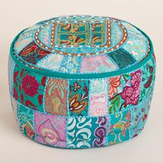 Made of vibrant recycled fabrics with embellishments and Indian patchwork, our exclusive Aqua Suti Pouf is a brilliant extra seating solution. This portable pouf adds color and comfort to any room.