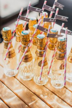 Mini Champagne Favors: You've danced, you've dined and now it's time to send guests home with a little something for later. Mini champagne bottles and striped straws will help keep the fun alive even after they get home. French Wedding, Mod Wedding, Wedding Gifts, Wedding Day, Paris Wedding, Wedding Season, Autumn Wedding, Summer Wedding, Wedding Photos