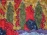 Abstract rug hooking by Deanne Fitzpatrick. Patterned green, yellow, red, blue, purple.