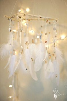 Hey, I found this really awesome Etsy listing at https://www.etsy.com/listing/218981424/dreamcatcher-mobile-shining-star-feather