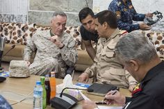Marine Corps Gen. Joe Dunford, chairman of the Joint Chiefs of Staff, meets with members of the coalition at a forward operating base near Qayyarah West, Iraq, April 4, 2017. DoD Photo by Navy Petty Officer 2nd Class Dominique A. Pineiro