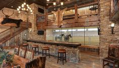 Here's a bar with a view of this barndo's indoor driving enviornment. Click by and scroll right down to the … House With Stables, Dream Stables, Dream Barn, Horse Barn Plans, Barn House Plans, Barn With Living Quarters, Horse Barn Designs, Horse Arena, Indoor Arena