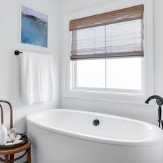 ideal bathroom for relaxation featuring woven wood shades from selectblindscom - Bathroom Window Treatments