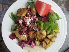 Green salad with radicchio, baked chicken tenders, goat cheese, walnuts, and roasted beets, served with broiled potatoes with herbs and watermelon...YUM
