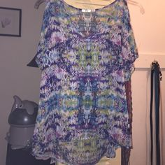 Shirt Multi colored blouse. Open sleeve. Beautiful colors. 100% polyester. Something will need to be worn underneath as it is somewhat sheer. Worn only a few times. Rumors Tops Blouses