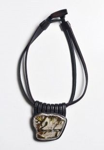 $1415.00 | Monies UNIQUE Tourmalinated Quartz and Ebony Necklace | Monies jewelry is bold in design and strong in aesthetic. This Monies necklace is made with Tourmalinated Quartz, Leather, and Ebonyl, to become a one-of-a-kind and edgy statement piece. All pieces are handmade. Monies is sold online and in-store at Santa Fe Dry Goods & Workshop in Santa Fe, New Mexico.