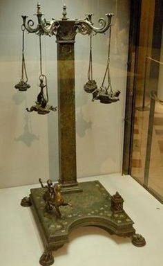 Pompeii, Bronze Candelabrum, House of Pansa: peristyle area. The candelabrum, set on lion claw feet, has 4 scrolled arms each supporting an oil lamp. On the base are a square altar & a statuette of Dionysus riding a panther Ancient Pompeii, Pompeii Ruins, Pompeii Italy, Pompeii And Herculaneum, Ancient Ruins, Ancient History, Ancient Artefacts, Ancient Civilizations, Ancient Roman Houses