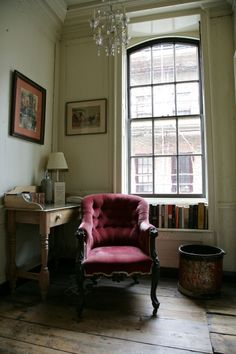 writing space....wide worn planks + tall window + velvet chair