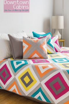 Downtown Cabins quilt and matching pillows from the book Cabin Fever: 20 Modern Log Cabin Quilts. at Piece N Quilt.