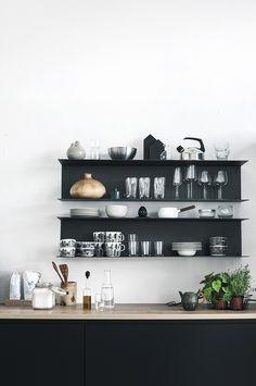 Black kitchen. Ikea shelves made of thin steel.